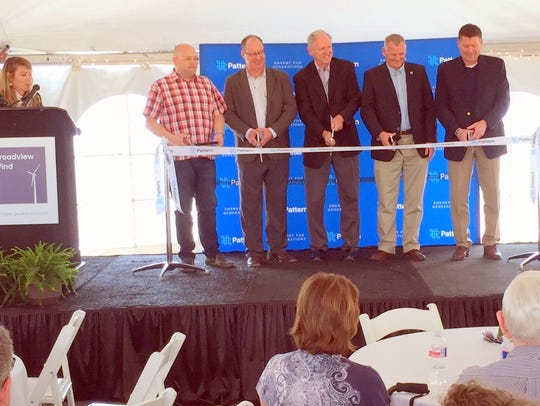 Set to cut the ribbon are from left, Ben McDaniel,