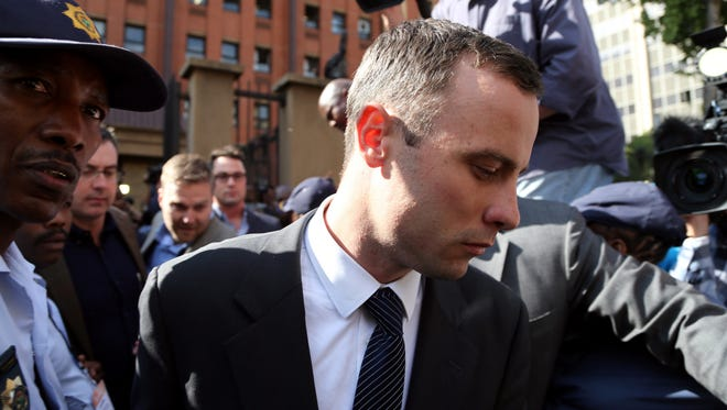 Oscar Pistorius, leaves the high court in Pretoria, South Africa, Tuesday.
