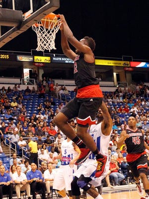 U of L's Chinanu Onuaku throws it down on Tuesday in San Juan.