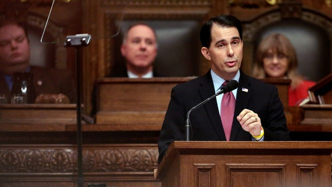 Gov. Scott Walker delivers his state budget address Tuesday at the state Capitol in Madison.