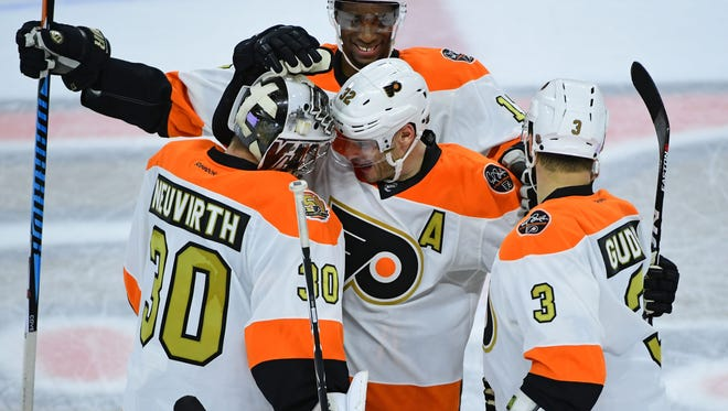 Mark Streit, center, scored the game-tying goal with 62 seconds left. The Flyers won in overtime to beat Detroit.