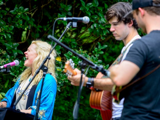 LoLo, Marrick Smith, and Bo Kitzman perform in a local home's lawn during the Porchfest music festival held around the LANA neighborhood at 316 Crescent Ave in Jackson, Tenn., Tuesday, July 31, 2018.