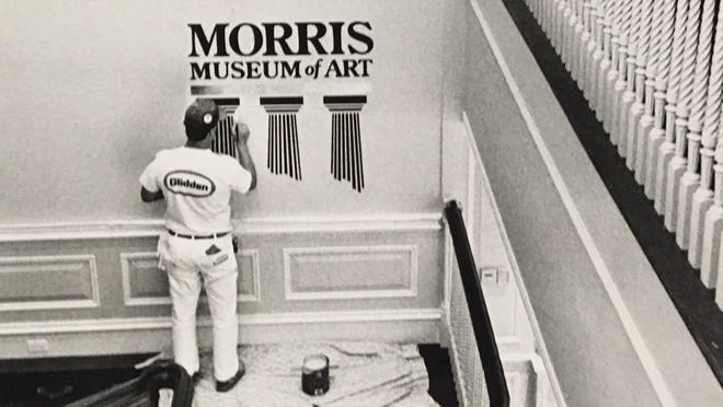 A painter prepares for the opening of the Morris Museum of Art.