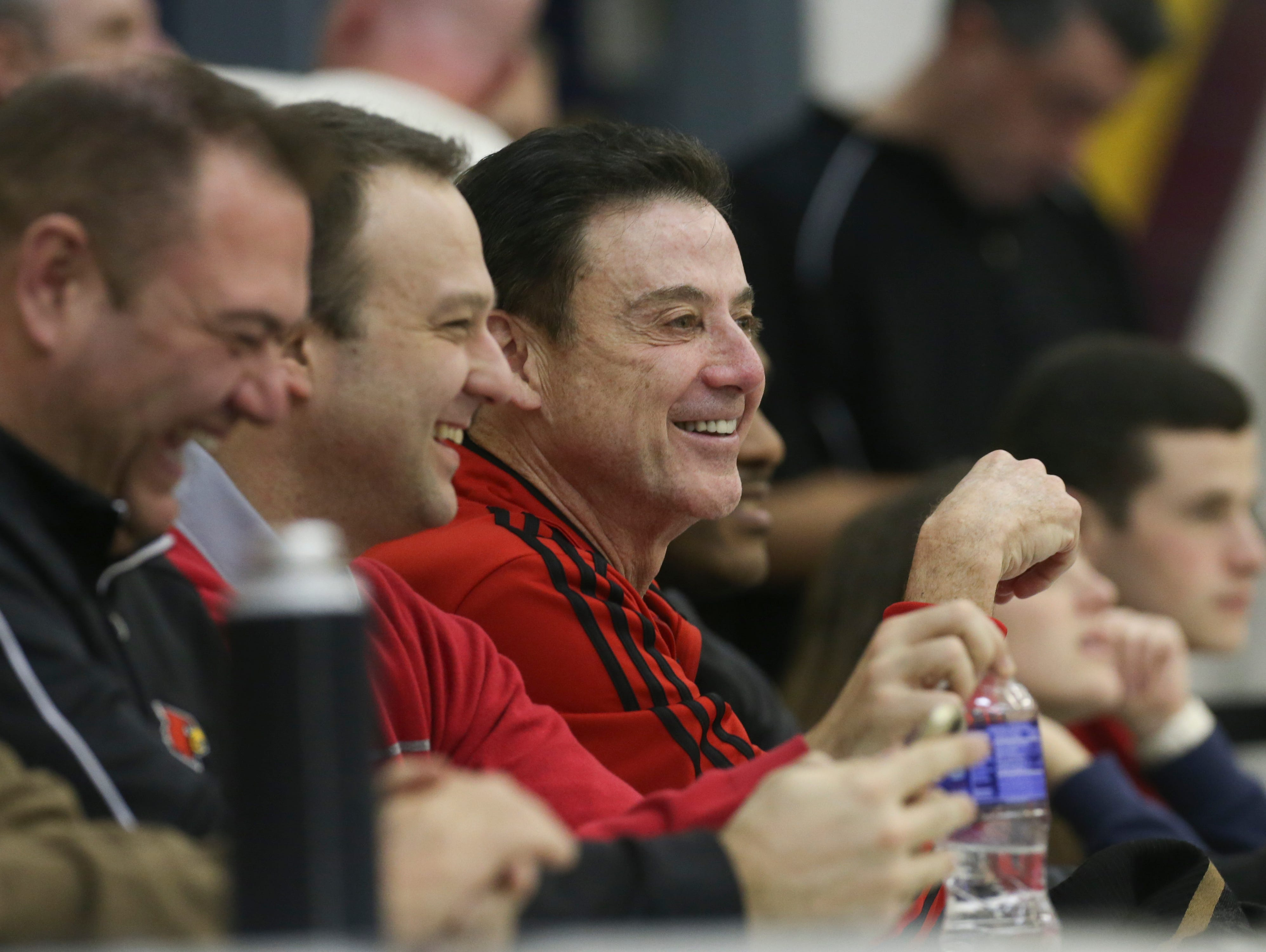 U of L head coach Rick Pitino, center, seemed pleased as he watched signee V.J. King's Paul VI Catholic High School squad defeat the North Bullitt High School in the King of the Bluegrass Tournament at Fairdale High School. King scored 35 points in the victory. Dec. 20, 2015