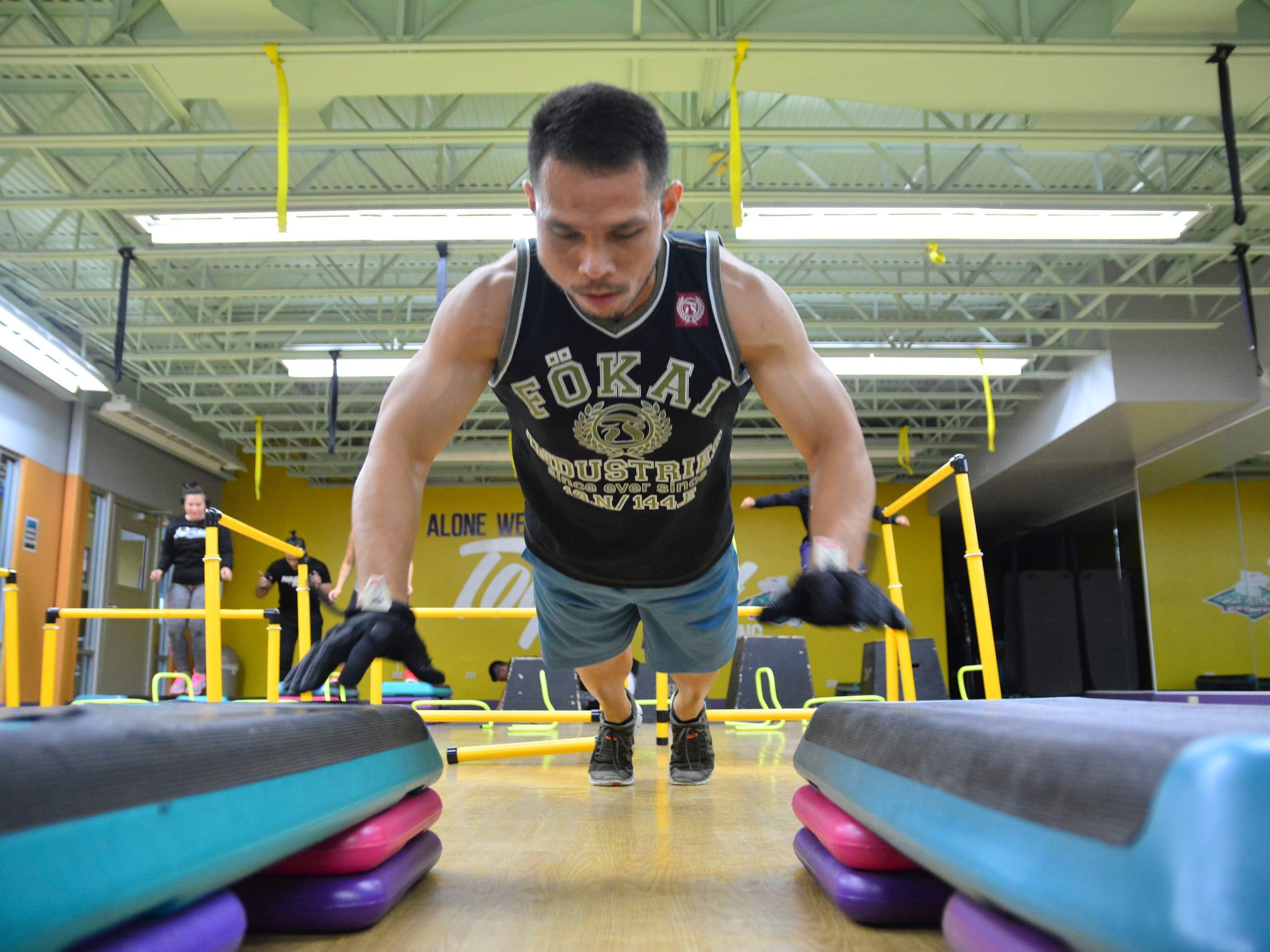 Anthony Sablan gets air between bi-level pushups in