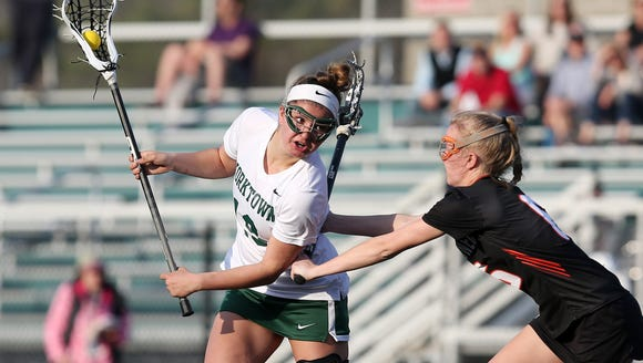 Yorktown's Caroline Garti (19) tries to get around