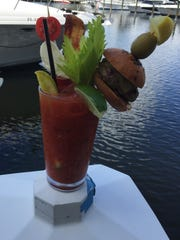 Fathoms garnishes its Over The Top Bloody Mary with a pickle spear, tomato-mozzarella skewer, celery, bacon and a Kobe-style beef slider.