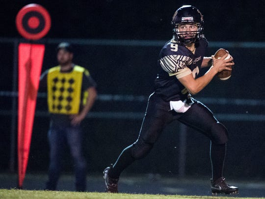 Biglerville quarterback Cage Althoff drops back to pass in the second quarter, Friday, September 23, 2017. The Knights lanced the Canners, 53-14, keeping Biglerville winless after Week 4.