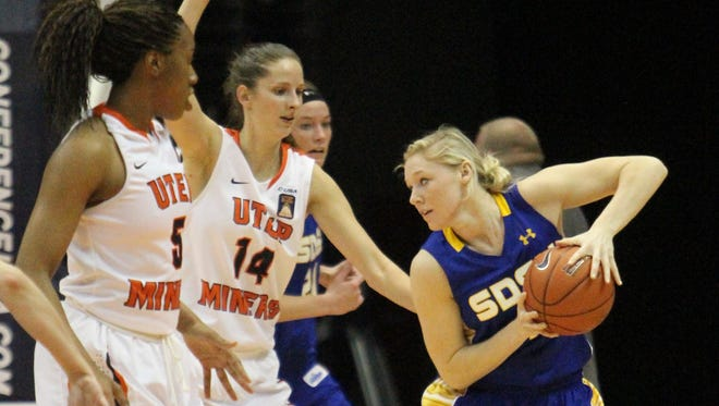 South Dakota State's Mariah Clarin, right, tries to work the ball inside against UTEP during an NCAA college basketball game in the semifinals of the WNIT, Wednesday, April 2, 2014, in El Paso, Texas. (AP Photo/El Paso Times, Rudy Gutierrez) EL PASO OUT   JUAREZ, MEXICO, OUT