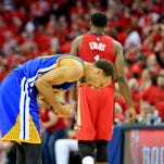 Golden State Warriors guard Stephen Curry (30) celebrates after a 3-point basket forced the game into overtime in game three of the first round of the NBA Playoffs at  the Smoothie King Center. The Warriors defeated the Pelicans 123-119 in overtime.