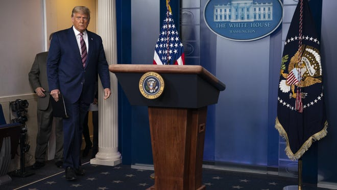 President Donald Trump arrives to deliver a statement on the election in the briefing room of the White House on Thursday.