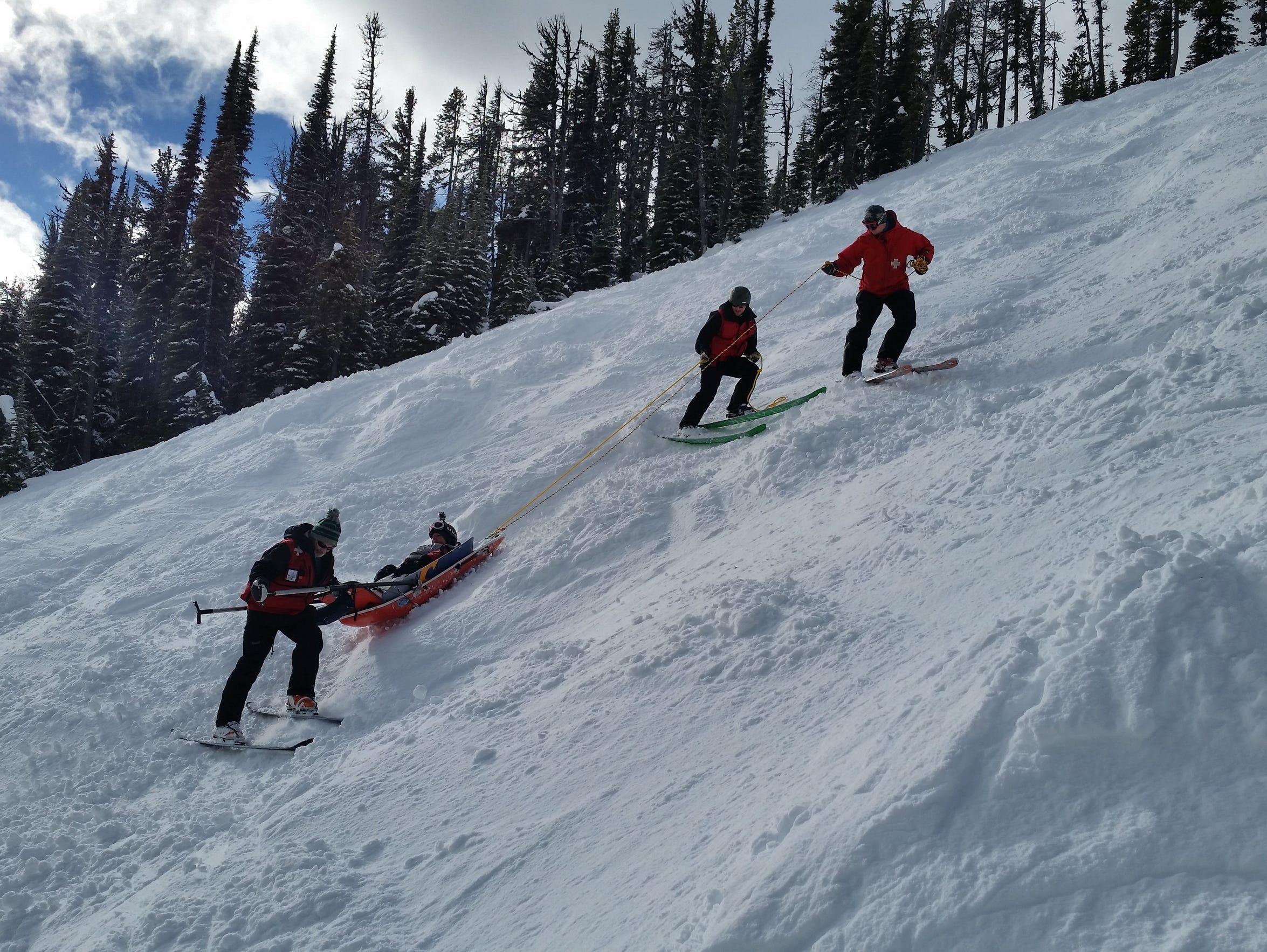 Great Falls Ski Patrol members practice taking a toboggan