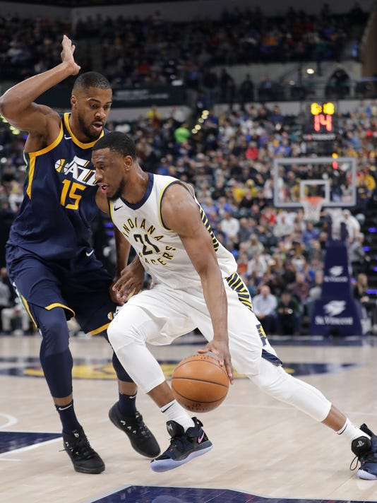 Indiana Pacers' Thaddeus Young goes to the basket as Utah Jazz's Derrick Favors defends during the first half of an NBA basketball game Wednesday, March 7, 2018, in Indianapolis. (AP Photo/Darron Cummings)