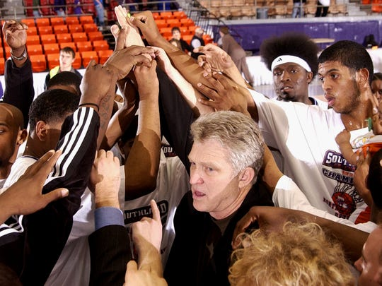 The Northwestern State Demons huddle after defeating the McNeese State to win the 2006 Southland Conference championship.
