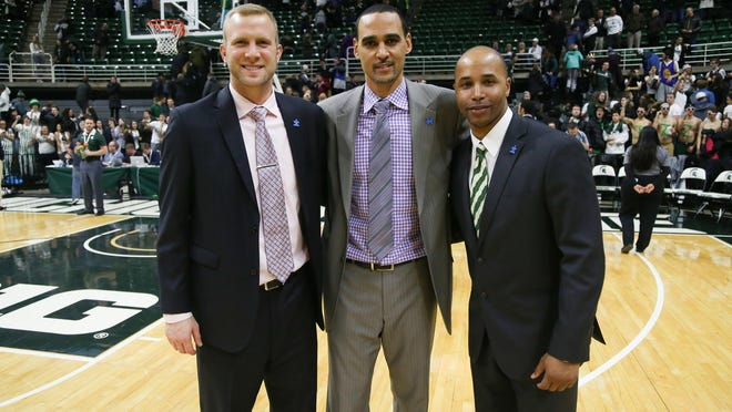 From left, former Spartans Austin Thornton (2008-12), David Thomas (1996-2000) and Thomas Kelley (1994-99) pose at Breslin Center last week. Thomas is in his first season as director of men's basketball operations. Thornton and Kelley are in their first of two seasons as graduate managers.