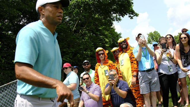 Patrons dressed as tigers watch as Tiger Woods walks to the 3rd hole during the second round of the Memorial Tournament at Muirfield Village Golf Club in Dublin, Ohio on Friday, May 31, 2019.