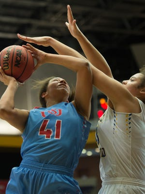 USJ's Ashton Hulme (41) shoots past BGA's Kyah Keller (43) during their game in the 2017 TSSAA State Basketball Championships at Allen Arena Friday, March 3, 2017 in Nashville, Tenn.