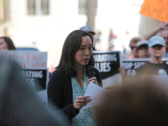 FILE -- State Rep. Stephanie Chang, D-Detroit, speaks during a rally to protect DACA on Tuesday, Sept. 5, 2017 at  Clark Park in Detroit as part of a national day of action.
