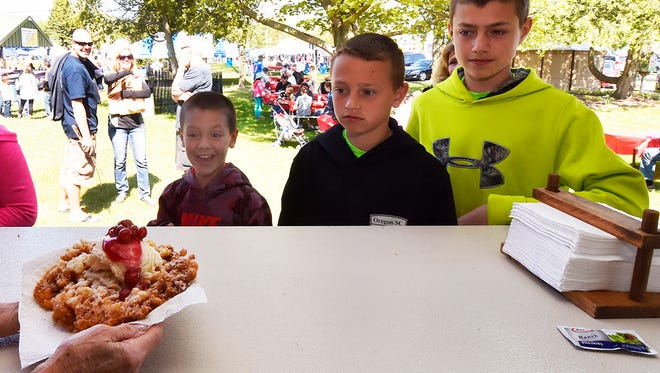 Okay, so it's the SECOND funnel cake topped with ice cream and cherries for Ben, Joey and Zack Zuehlke of Oregon, Wis.