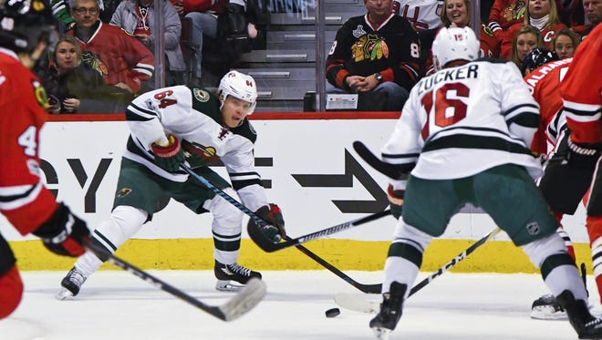 Minnesota Wild center Mikael Granlund (64) passes the puck against the Chicago Blackhawks during the first period of an NHL hockey game on Sunday, Jan. 15, 2017, in Chicago.