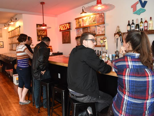 Patrons enjoy some beverages and buy some vinyl records