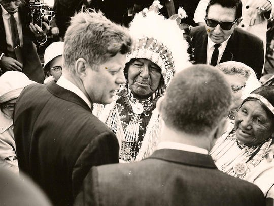 John F. Kennedy conversing with an Oglala Sioux chief immediately following his speech at the Oahe Dam dedication in 1962.
