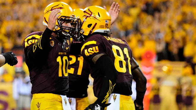 Arizona State wide receiver Gary Chambers and quarterback Taylor Kelly celebrate after a touchdown pass during the first half.