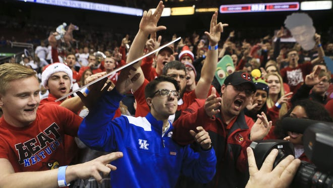 UK fan Aiden Dunn gets heckled by Louisville fans as the crowd mugs for the TV camera before the start of December's U of L-Kentucky basketball game.