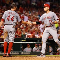 Reds first baseman Joey Votto celebrates with pitcher Mike Leake after hitting a three-run home run in the sixth inning.