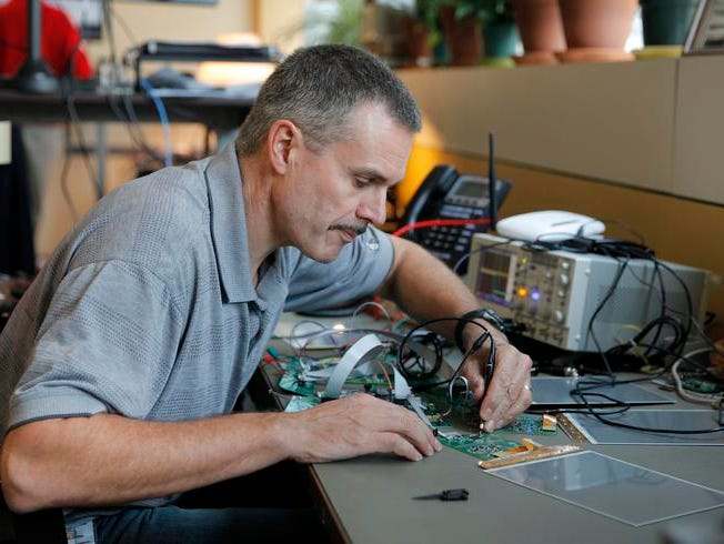 Kevin Carolan, an embedded design engineer at Omni ID, works on circuitry in the developement of a new display product. Omni ID makes view tags called the Pro View system for manufacturing use.