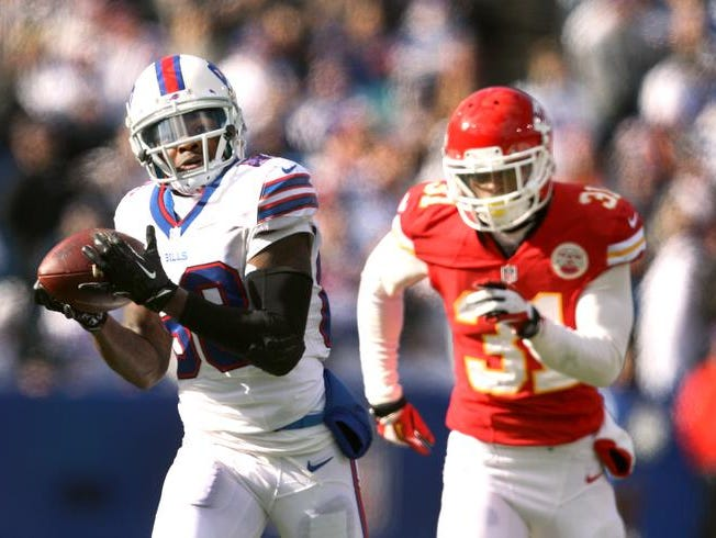 Bills rookie receiver Marquise Goodwin (88) catches a 59 yard touchdown pass behind Chiefs Marcus Cooper (31).