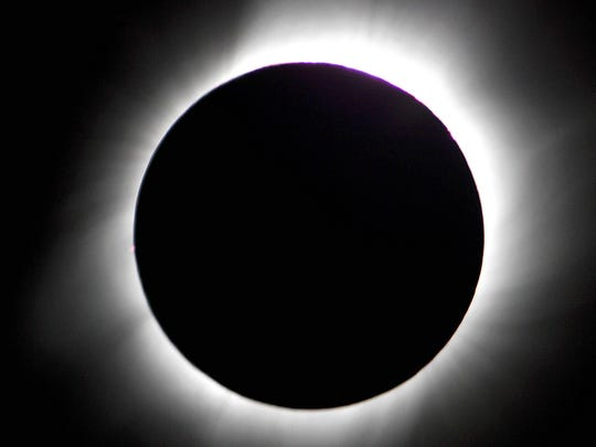 A total solar eclipse is seen on March 29, 2006 above