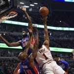Chicago Bulls guard Derrick Rose (1) is defended by