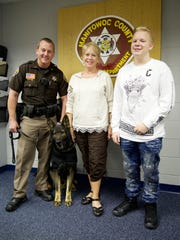 Lt. Cummings, K-9 Keto, Roslyn Faken and Joey Burrows