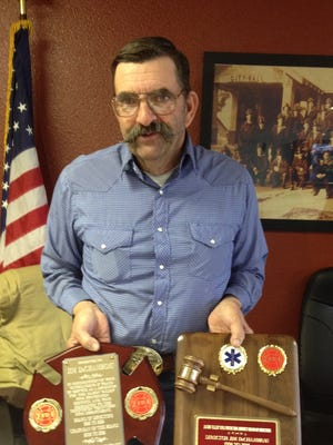 Jim DeChambeau received two plaques at the Dec. 20 Mason Valley Fire Protection District meeting in recognition of his 16 years serving on that board and eight years as its chairman.