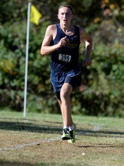 Seton Catholic's Jacob Stamm leads the cross country sectional boys race Saturday, Oct. 10, 2015 in Connersville.