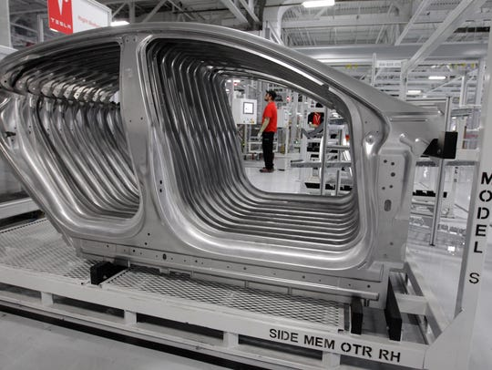 Tesla Model S frames are shown in the assembly area