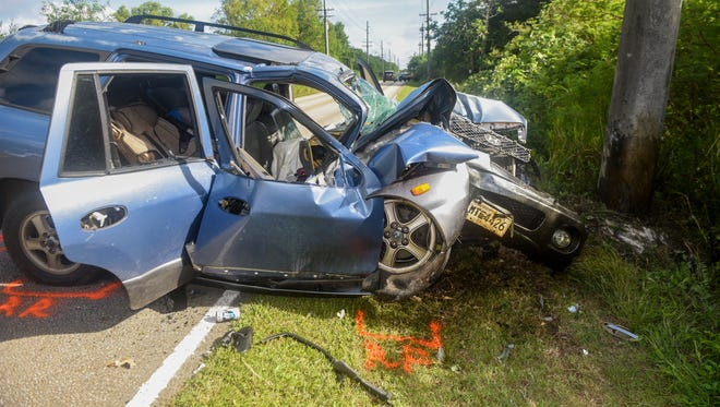 Guam Police Department Highway Patrol officers conduct an investigation of an auto-pole collision, involving a blue Hyundai Santa Fe vehicle, on Route 4A in Talofofo on Jan. 4, 2017.