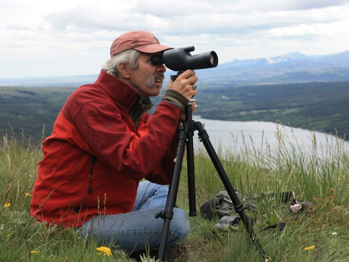 Joel Berger, one of the six finalists for the Indianapolis Prize, observes mountain goats in Glacier National Park.