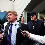Hulk Hogan, whose given name is Terry Bollea, left, looks on in court moments after a jury returned its decision Monday, March 21, 2016, in St. Petersburg, Fla. A jury has hit Gawker Media with $15 million in punitive damages and its owner with $10 million, adding to the $115 million it awarded last week for publishing a sex video of Hogan. (Dirk Shadd/The Tampa Bay Times via AP, Pool) NEW YORK POST OUT