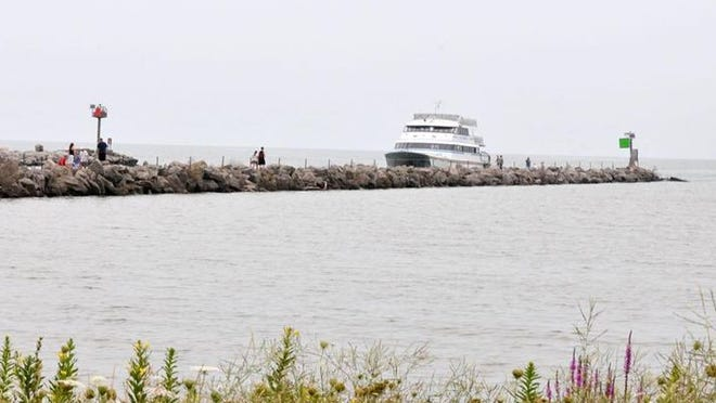 Toledo's recent drinking water crisis has brought attention to the toxic blue-green algae that could plague Lake Erie waters and threaten the area's tourism industry.