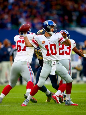 Eli Manning #10 of the New York Giants throws the ball during the NFL International series game between Los Angeles Rams and New York Giants at Twickenham Stadium on October 23, 2016 in London, England.