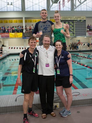 Piedra Vista's Ben VanOtteson (top middle) and Farmington's Raimi Clark (top right) pose with their coaches Nancy Pinckley (far left), Ian Donaldson and Kristi Lucero at the state swimming and diving competition on Saturday at Albuquerque Academy High School.