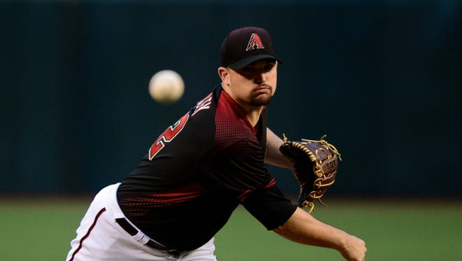 Jun 10, 2017: Arizona Diamondbacks starting pitcher Zack Godley (52) throws during the first inning against the Milwaukee Brewers at Chase Field.