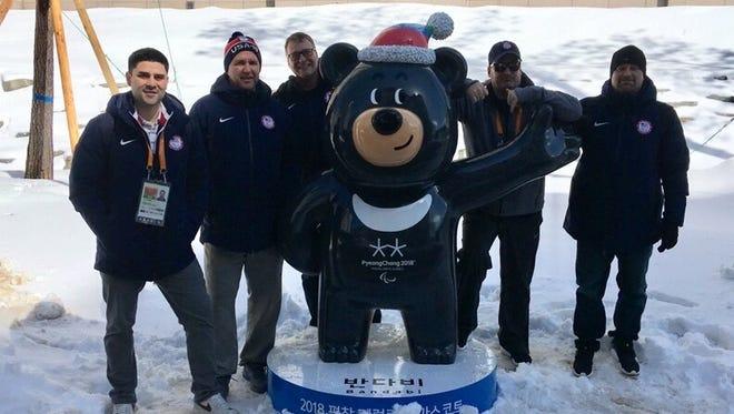 USA Sled Hockey media manager Jon Gomez, assistant coach David Hoff, team physician Mike Uihlein, general manager Dan Brennan, and head coach Guy Gosselin meet Paralympics mascot Bandabi.