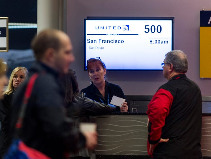 Passengers begin boarding Flight 500, non-stop to San Francisco. United Airlines, the Indianapolis Airport Authority and The Indiana Economic Development Corp., sent off the city's inaugural flight of non-stop service to San Francisco Wednesday, Jan. 8, 2014.
