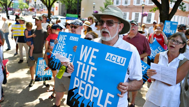 More than 100 people gather for the Families Belong Together Rally in Continental Square in York City, Saturday, June 30, 2018. The peaceful protest is one of hundreds of events taking place nationwide in opposition of family separation and internment camps that have become the result of government policy on immigrants and refugees caught illegally crossing the boarder between the U.S. and Mexico. Dawn J. Sagert