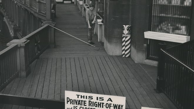 The riverwalk behind the First Wisconsin National Bank at 735 N. Water St. was closed to pedestrian traffic on Oct. 28-29, 1949. The reason: Leaving the walkway open to the public for too many consecutive years would make the riverwalk revert to public ownership.