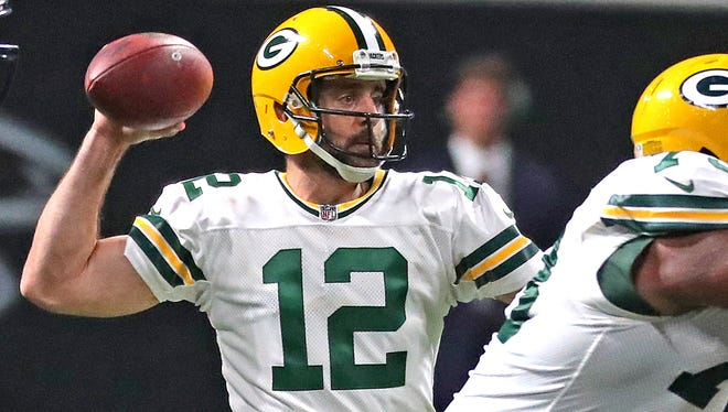 Packers quarterback Aaron Rodgers completes a first down pass to running back Ty Montgomery.