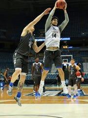 MTSU guard Chase Miller grabs a rebound in practice